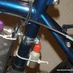 Ölflaschen-Halter am Rahmen